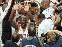 Photo of Michael Jordan and the Chicago Bulls Celebrating a National Championship Win