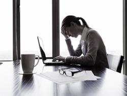 professional woman stressed at her computer