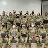 Photo of a group of Texas National Guard soldiers at a project management training graduation